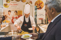 Cook working at Tuttofood 2015 in Milan, Italy Stock Image