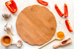Cook workplace with kitchen tools and cutting pepper white background top view Royalty Free Stock Image