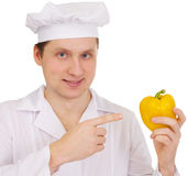 Cook with yellow paprica in hand Stock Images