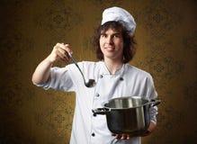 Cook z garnkiem Zdjęcia Royalty Free