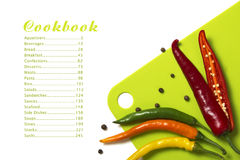 Cookbook. Menu: chilli, paper, board green Royalty Free Stock Images