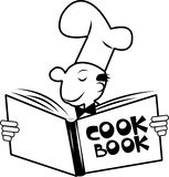 Cookbook. Chef holding up his cookbook reading the recipes inside Royalty Free Stock Image