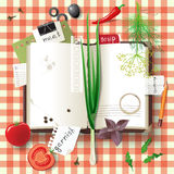 Cookbook. Highly detailed open cookbook with herbs and vegetables Stock Photo