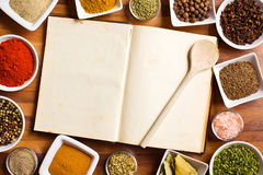 Cookbook And Various Spices And Herbs. Stock Images