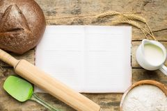 Cookbook with baking ingredients Stock Images