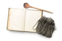 Cookbook and black noodles with squid sepia ink Stock Photos