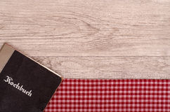 Cookbook on checkered table cloth Stock Images
