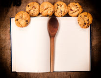 Cookbook and cookies. Blank cookbook and homemade sweet cookies Royalty Free Stock Images