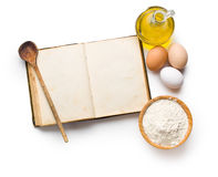 Cookbook and ingredients for preparing pasta Royalty Free Stock Images