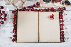 Cookbook with ingredients. And red fruits royalty free stock photo