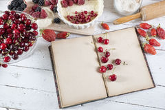 Cookbook with ingredients. And red fruits royalty free stock images
