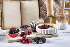 Cookbook with ingredients. And red fruits royalty free stock photography