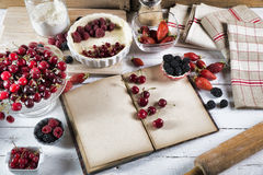 Cookbook with ingredients. And red fruits royalty free stock photos