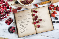 Cookbook with ingredients. And red fruits stock photo
