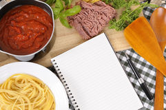 Cookbook with recipe ingredients for Italian spaghetti bolognese, copy space Royalty Free Stock Photo