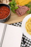 Cookbook with ingredients for Italian spaghetti bolognese, copy space Royalty Free Stock Photos