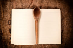 Cookbook and ladle Royalty Free Stock Photos