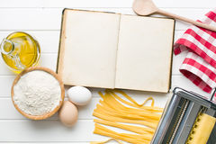 Cookbook and pasta ingredients Stock Image