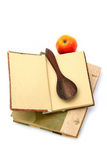 Cookbook and spoon Royalty Free Stock Photo