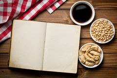 Cookbook with various soy products. Top view of cookbook with various soy products Stock Photo