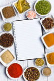 Cookbook and various spices and herbs. Royalty Free Stock Photo