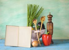 Cookbook, vegetables,old kichen utensils, free copy space Royalty Free Stock Photography