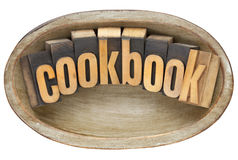 Cookbook in wooden bowl Stock Photos
