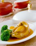 Cooked abalone and vegetable Stock Photos