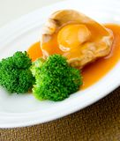 Cooked abalone and vegetable Stock Image