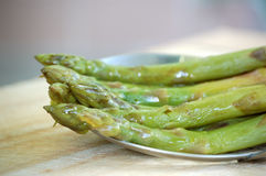 Cooked Asparagus. Boiled and sauteed asparagus ready for serving Royalty Free Stock Photography
