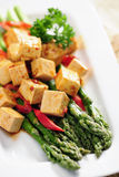 Food: Cooked Asparagus and marinated Tofu Royalty Free Stock Image