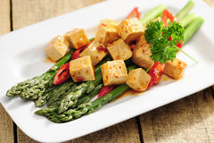Food: Cooked Asparagus and marinated Tofu Stock Photo