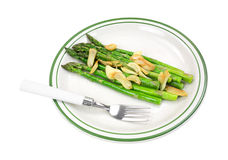 Cooked asparagus on plate with fork Royalty Free Stock Photo