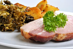 Cooked back bacon joint with savoy cabbage Stock Images