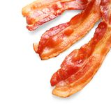 Cooked bacon rashers on background. Cooked bacon rashers on white background Royalty Free Stock Photography