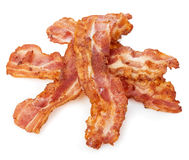 Cooked bacon rashers close-up isolated on a white background. stock image