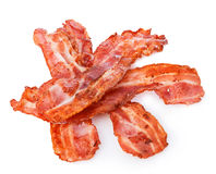 Cooked bacon rashers close-up  on a white background.  Royalty Free Stock Photos