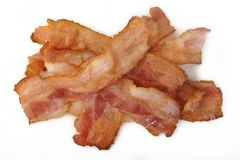 Cooked bacon rashers. On a white background Stock Photography
