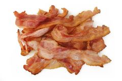 Cooked bacon rashers. On white background Royalty Free Stock Photos
