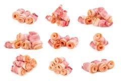 Cooked bacon rashers isolated on white royalty free stock image