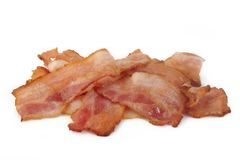 Cooked bacon rashers. On a white background Stock Images