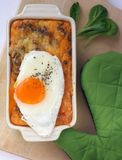 Cooked and baked lentils with eggs Royalty Free Stock Images
