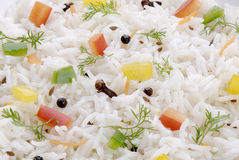 Cooked Basmati Rice. Boiled Basmati Rice with clove black pepper red and yellow pepper Stock Photos