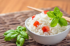 Cooked basmati rice with tomato and basil. Basmati Rice in a bowl for lunch Royalty Free Stock Photo