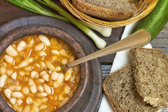 Cooked beans in clay bowl Stock Photography