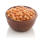 Cooked beans with red sauce in a clay bowl Royalty Free Stock Photography