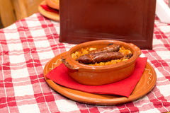 Cooked beans with sausages and leather menu book Stock Image