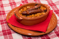 Cooked beans with sausages and salad Stock Photography