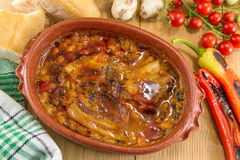 Cooked beans in a traditional pottery bowl Stock Images