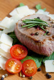 Cooked Beef on arugula and parmesan Stock Image